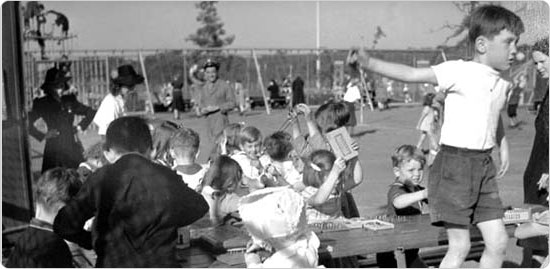 Children at a picnic table in Van Cortlandt Park, playing games, October 1, 1939. Courtesy of Parks Photo Archive.