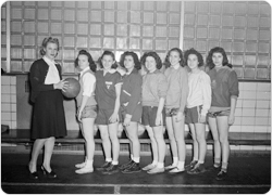 1945 Betsy Head girls basketball team poses at a tournament (March 9, 1945).