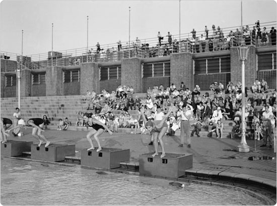 Swimmers on the starting block at an Astoria Pool swim meet, August 17, 1943. Courtesy of Parks Photo Archive, Neg. 22587.