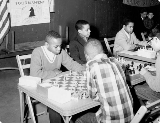 A chess tournament at Colonial Park (now Jackie Robinson Park), part of an effort to expand cultural recreation in parks, March 5, 1966. Courtesy of Parks Photo Archive.