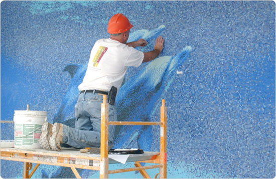 Placing the final tiles in the Chelsea Recreation Center mural, September 23, 2003. Photo by Spencer T. Tucker.