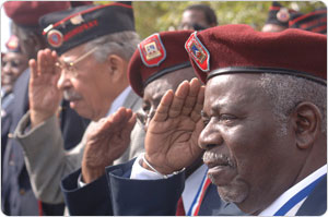 Veterans salute at the 369th Infantry Regiment monument unveiling, September 29, 2006. Photo by Daniel Avila.