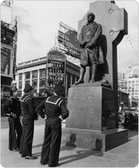Three sailors gaze up at the Father Francis Patrick Duffy statue in Duffy Square, October 12, 1941. Courtesy of Parks Photo Archive, Neg. 20990.2.