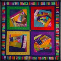 Photo of a quilt from the Reaching for the Sun gallery exhibit, links to more information and pictures from the show.