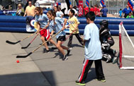 Kids playing street hockey