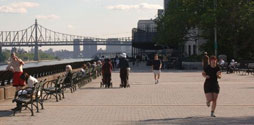 People running and walking in Carl Schurz Park