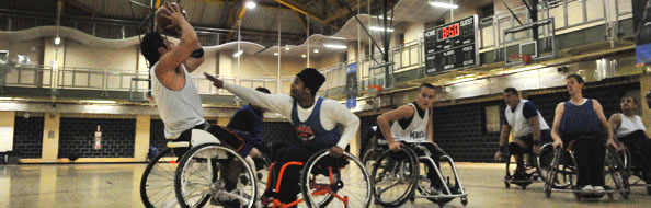 People playing wheelchair basketball at a recreation center