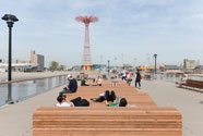 Coney Island pier with parachute drop in background