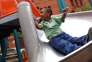 kid sliding down a spiral slide