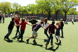 Children Playing at J.J. Byrne Playground's Synthetic Turf Field