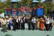 Cutting the ribbon at Story Playground