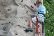 Enjoying the challenge of a rock climbing wall