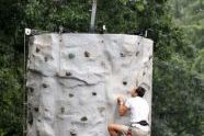 Scaling a rock climbing wall