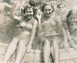 Smiling women and children, outdoor swimming pool (Location probable)