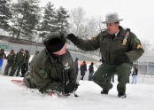 A man is instructed in the ways of ice rescue.