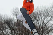 A talented snowboarder in the air.