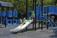 Sliding through Marine Park's Lenape Playground