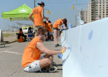 Volunteering to Paint the Barriers at Shore Road in Rockaway Beach
