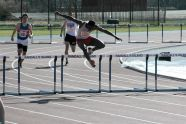 Hurdling at the PSAL season opening meet