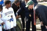 Ed Lewis, Charles Rangel, and Woody Johnson interview a future athletic star