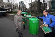 Sanitation Commissioner John J. Doherty & Parks Commissioner Adrian Benepe demonstrate how to recycle
