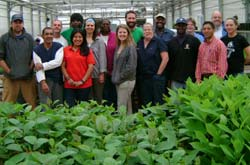 GNPC staff photo in a greenhouse