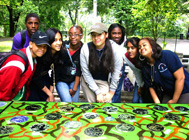 Students from PS 219 gather behind their work at Claremont Park, Bronx. Photo courtesy of LEAP.
